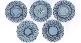 Spirella Scrapbook Embellishments with blue thread on blue paper